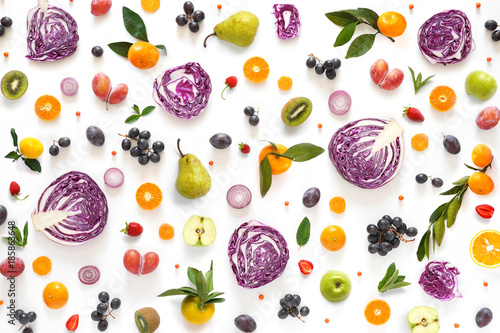 Composition pattern made from fresh vegetables and fruits isolated on white background.  Top view, flat design. Food texture (red cabbage in a cut, plums, grapes, mandarins, pears, apples) - 185863648