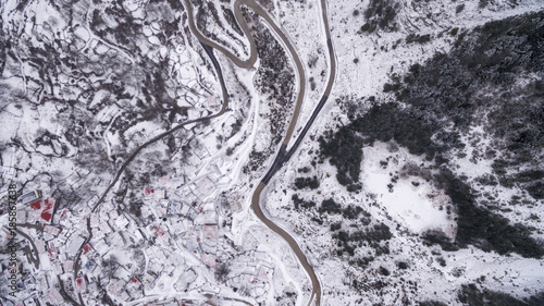 Foto op Canvas Lavendel Aerial drone image of the amazing Metsovo town in Northern Greece covered in snow.