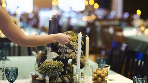 In de dag Buffet, Bar Еhe lighting of a candle in a restaurant. the decor with moss.