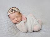 Newborn baby girl swaddled in wrap - 185881293