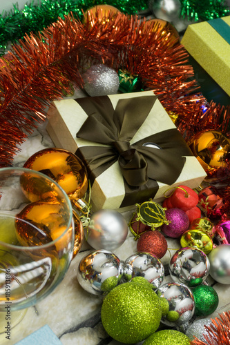 Festive Christmas and New year background Wallpapers or cards . Christmas tinsel, decorations, gifts, and other attributes of the holiday on a brown wooden surface. - 185913886