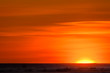 Vivid yellows, oranges, and reds of sunset over the frozen tundra of Hudson Bay, Manitoba, Canada