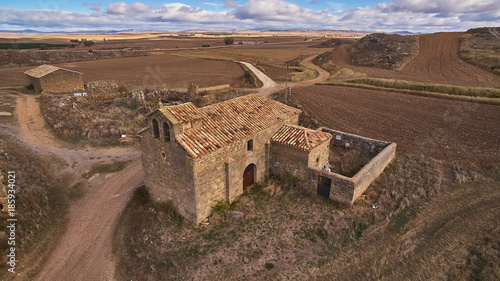 Tuinposter Diepbruine Boñices ghost town in a cloudy day in Soria province, Spain