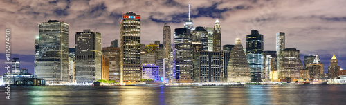 Fototapeta New York City skyline panorama at night, USA.