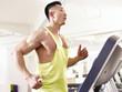 asian bodybuilder running on treadmill