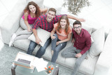 view from the top.a group of laughing friends sitting on the sofa - 185990466