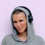 Tomboy Girl in stylish headphones. Clubbing DJ vibes - 186015888
