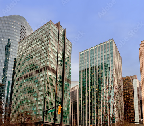 Foto op Plexiglas Canada Modern high-rise buildings with glass windows and reflection