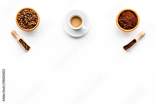 Coffee concept. Roasted beans, ground coffee, cup of espresso on white background top view copyspace - 186026823