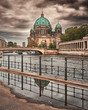 Berlin cathedral, Berliner Dom, suggestive winter atmosphere, people walking and cycling in front of cathedral