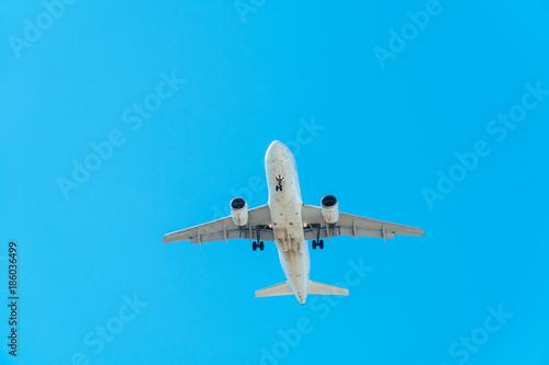 Passenger Plane Flying On Clear Blue Sky