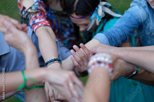 Woven hands of people during the performance of folk dance in the open air