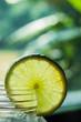 Lemon slice on glass jar.