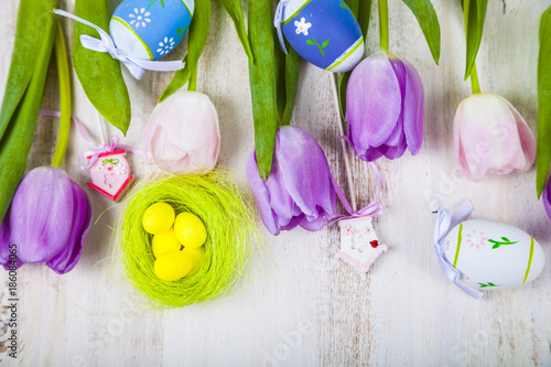 Foto Murales Bouquet purple tulips and Easter eggs