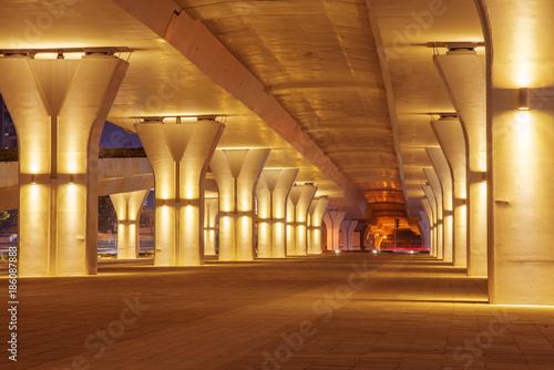 empty sidewalk below elevated road in modern city - 186087883