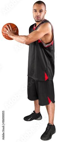 Fotobehang Basketbal Basketball Player Holding a Ball - Isolated