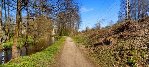 Fotobehang Panoramafoto s Panoramic view of small river, trail and railway embankment