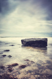 Rock on a beach, peaceful natural background, color toned picture, selective focus. - 186115258