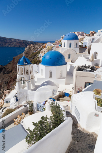 Fotobehang Santorini Cityscape of Oia, traditional greek village with blue domes of churches, Santorini island, Greece.