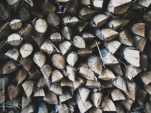 Poster Brandhout textuur Abstract photo of a pile of natural wooden logs background dry chopped firewood logs ready for winter