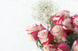 Beautiful bouquet of red and white roses with baby's breath. Selective focus with shallow depth of field.