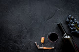 Open the wine. Corkscrew near bottle on black background top view copyspace - 186140824