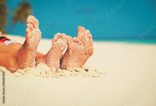family feet on summer tropical beach - 186183409