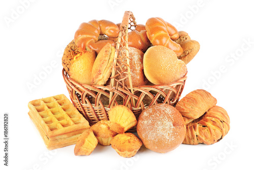 Bread and baked goods in a wicker basket isolated on a white background - 186192820