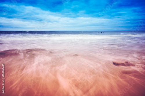 Motion blurred waves, peaceful natural background, color toning applied Poster