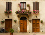Facade of old house in Pienza