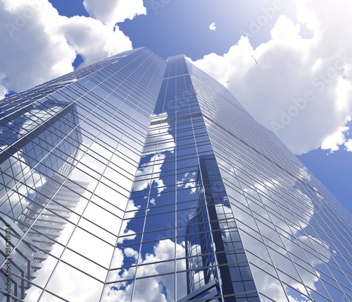 Fridge magnet skyscraper a beautiful modern high-rise building of metal and glass against the sky with clouds