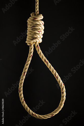 Brown rope noose dark and light on black background, concept of hanging suicide