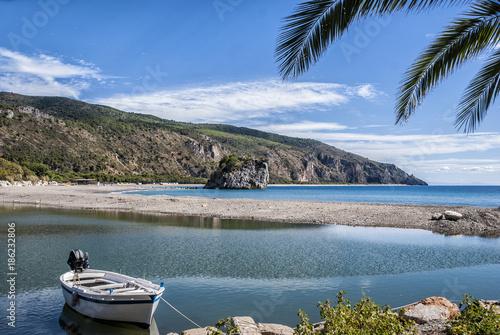 Foto Murales Moored wood boat, by Mingardo beach, from Palinuro village, Italy