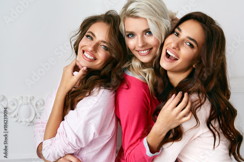 Female Friends Having Fun Together At Home Party