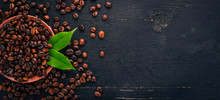 "Постер, картина, фотообои ""Coffee beans. On a wooden background. Top view. Copy space."""