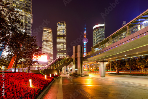 Fotobehang Shanghai Century Avenue at Night - A night view of broad, bright, colorful and modern sidewalk of Century Avenue, a major street at heart of Lujiazui financial district, Pudong, Shanghai, China.