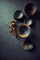 Still life with hand crafted japanese ceramic on stone background
