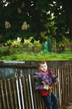 Portrait of a boy with a bouquet of lilacs . Dressed child holding a bouquet of flowers of lilac - 186278052