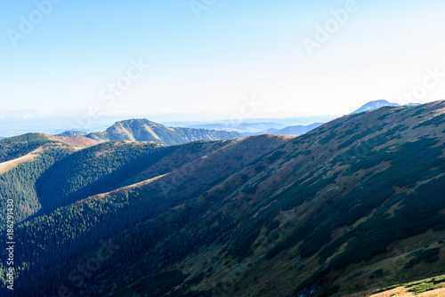 Fotobehang Nachtblauw slovakian carpathian mountains in autumn. sunny hill tops in summer