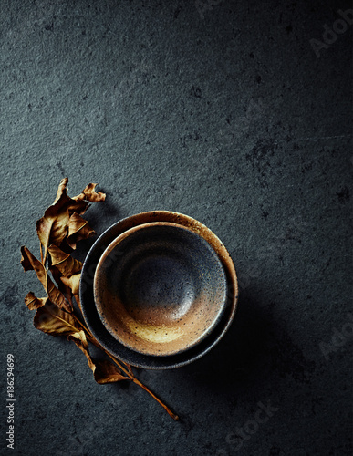 Foto Murales Still life with hand crafted japanese ceramic on stone background