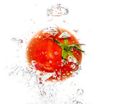 Red tomato under water on a white background