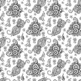 Black and white background with floral patterns.