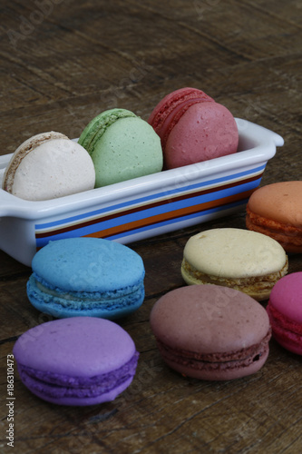 Keuken foto achterwand Macarons Colorful macarons on rustic wood table