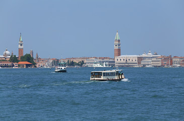 cityscape View of the island of VENICE in Italy with the ancient palaces and bell towers from the ferry boat called Vaporetto in italian language
