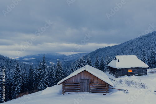 Fotobehang Winter Fantastic winter landscape with wooden house in snowy mountains. Christmas holiday concept. Carpathians mountain, Ukraine, Europe