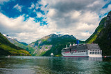 Breathtaking view of Sunnylvsfjorden fjord and cruise ship, near Geiranger village in western Norway.