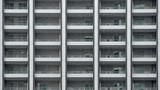 Highrise facade in the rain slow motion - 186347860