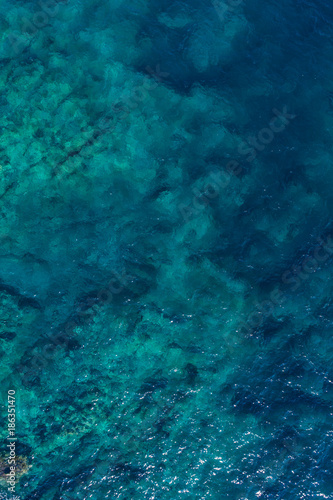 Tuinposter Groen blauw Aerial view on green waves, seabed texture