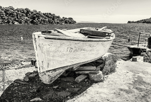 Foto op Aluminium Schip Old fishing boat with cracked white paint, Solta island, colorless