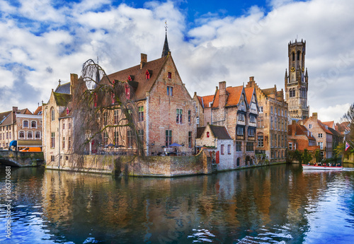 Papiers peints Bruges Famous Belfry tower and medieval buildings along a canal in Bruges, Belgium